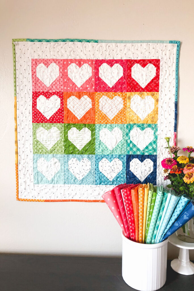 Heart Mini Quilt by top US sewing blog Ameroonie Designs. Image of: hearts sewn into a mini quilt using  Bee Basics fabrics.