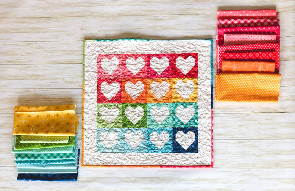 Heart Mini Quilt by top US sewing blog Ameroonie Designs. Image of: heart mini quilt with fabrics from Bee Basics line.