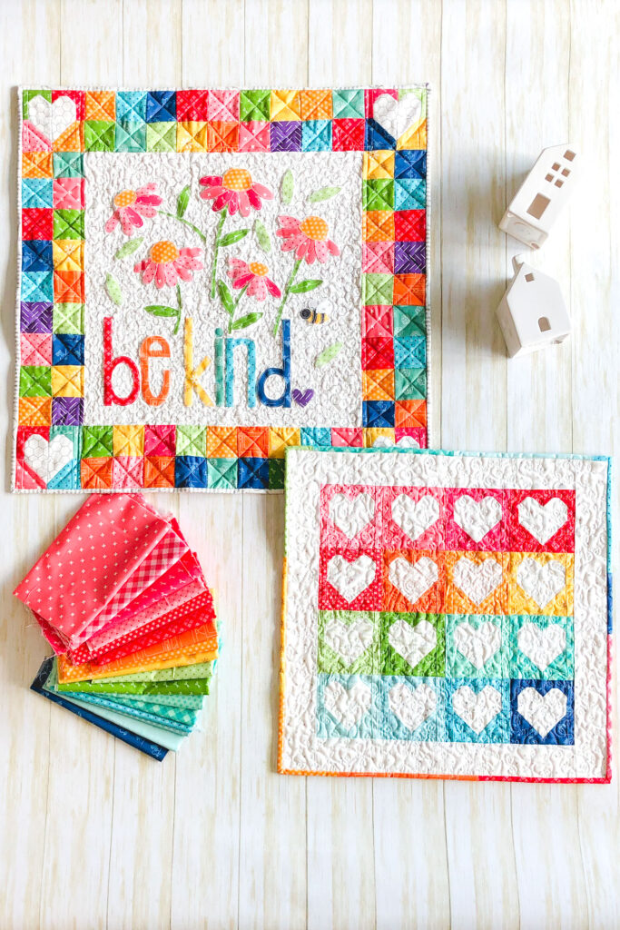 Heart Mini Quilt by top US sewing blog Ameroonie Designs. Image of: rainbow colored mini quilts.