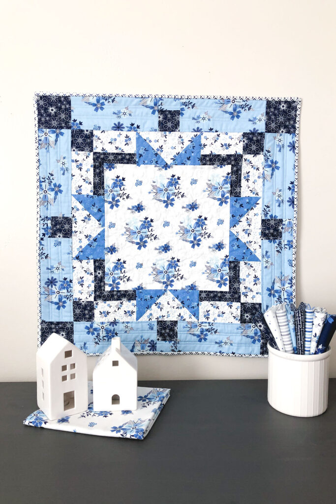 Easy table topper quilt by Top US sewing blog Ameroonie Designs. Image of: mini quilt with Blue Stitch fabric.