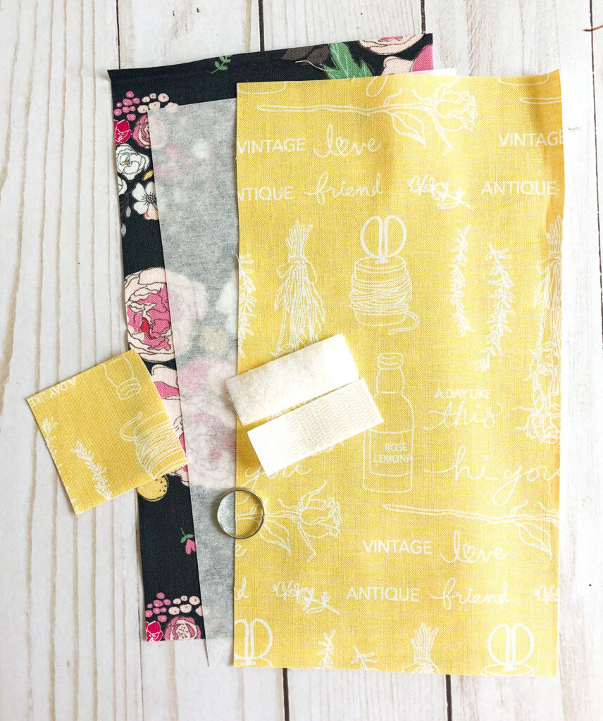 Accessorize your face mask tutorials by top US sewing blog Ameroonie Designs. Image of supplies to make mask pouch.
