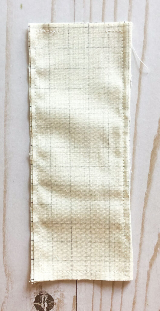 Scraptastic and simple Strip Pincushion by top US sewing blog Ameroonie Designs. Image of: preparing pouch for weight.