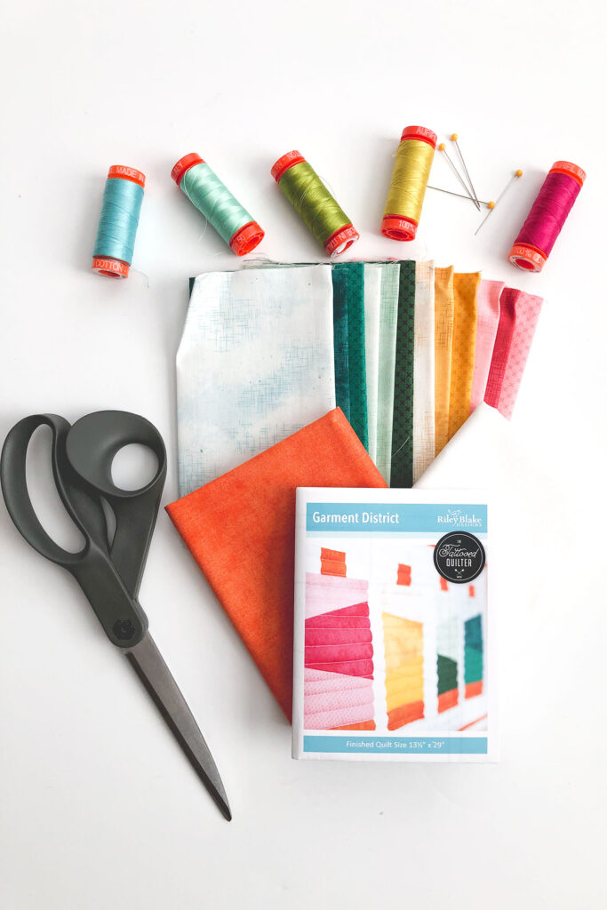 Fabric included in Garment District mini quilt kit with sewing supplies.