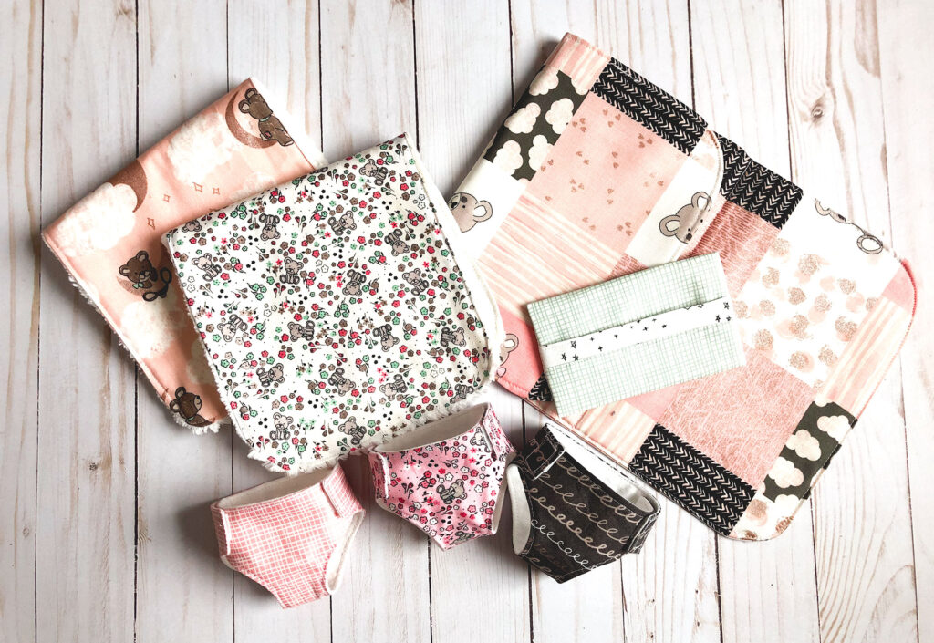 Pretend Play Diaper bag with top US sewing blog Ameroonie Designs. Image of changing pad, burp cloths, wipes case and diapers in Sleep Tight fabric.