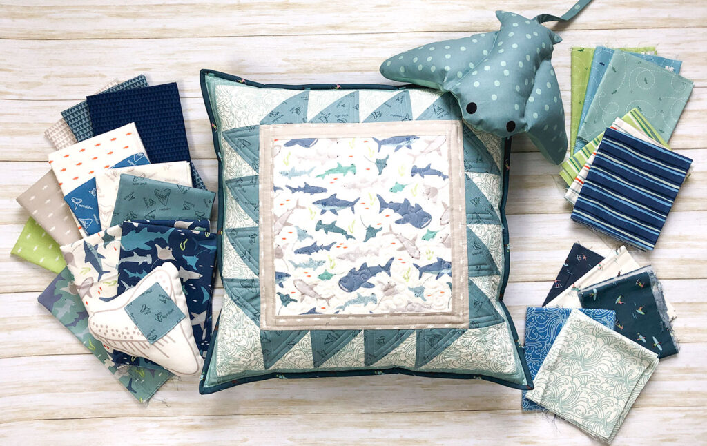Shark teeth pillow by top US sewing blog Ameroonie Designs. Image quilted pillow and Riptide quilting fabric.