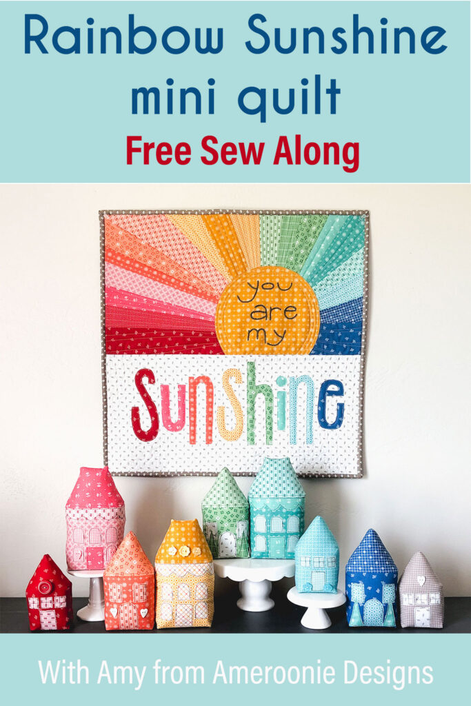 Rainbow Sunshine Mini quilt sew along with top US sewing blog Ameroonie Designs. Image of mini quilt with fabric stuffed houses.