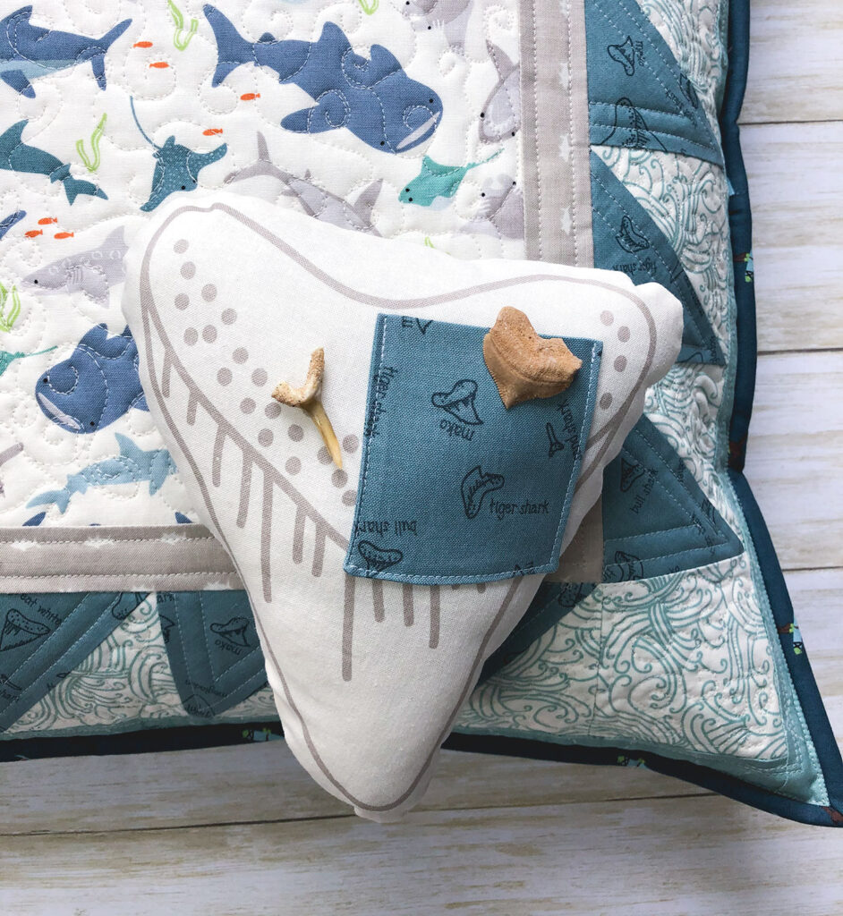 Shark teeth pillow by top US sewing blog Ameroonie Designs. Image of shark tooth mini pillow with real shark teeth.