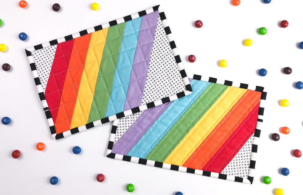 Wide Stripe Modern Rainbow mug rug tutorial by top US sewing blog Ameroonie Designs. Image of finished mug rugs with skittles.