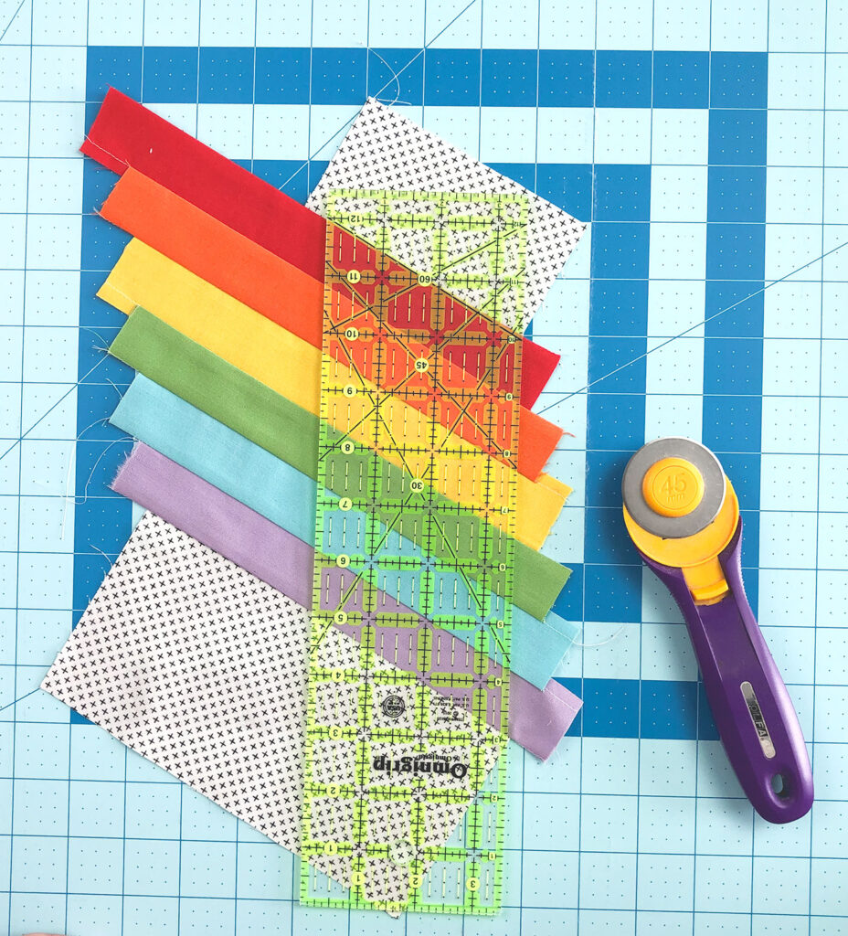 Wide Stripe Modern Rainbow mug rug tutorial by top US sewing blog Ameroonie Designs. Image of squaring top of mug rug front.