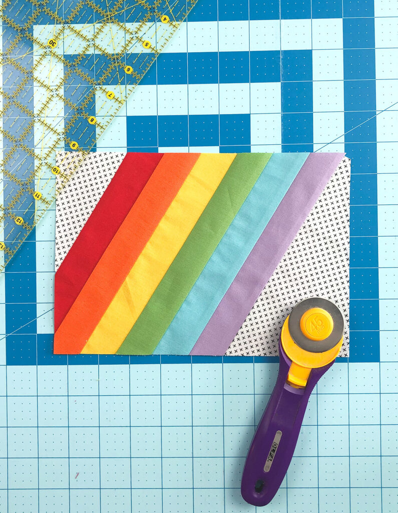 Wide Stripe Modern Rainbow mug rug tutorial by top US sewing blog Ameroonie Designs. Image of final squaring cuts for mug rug front.