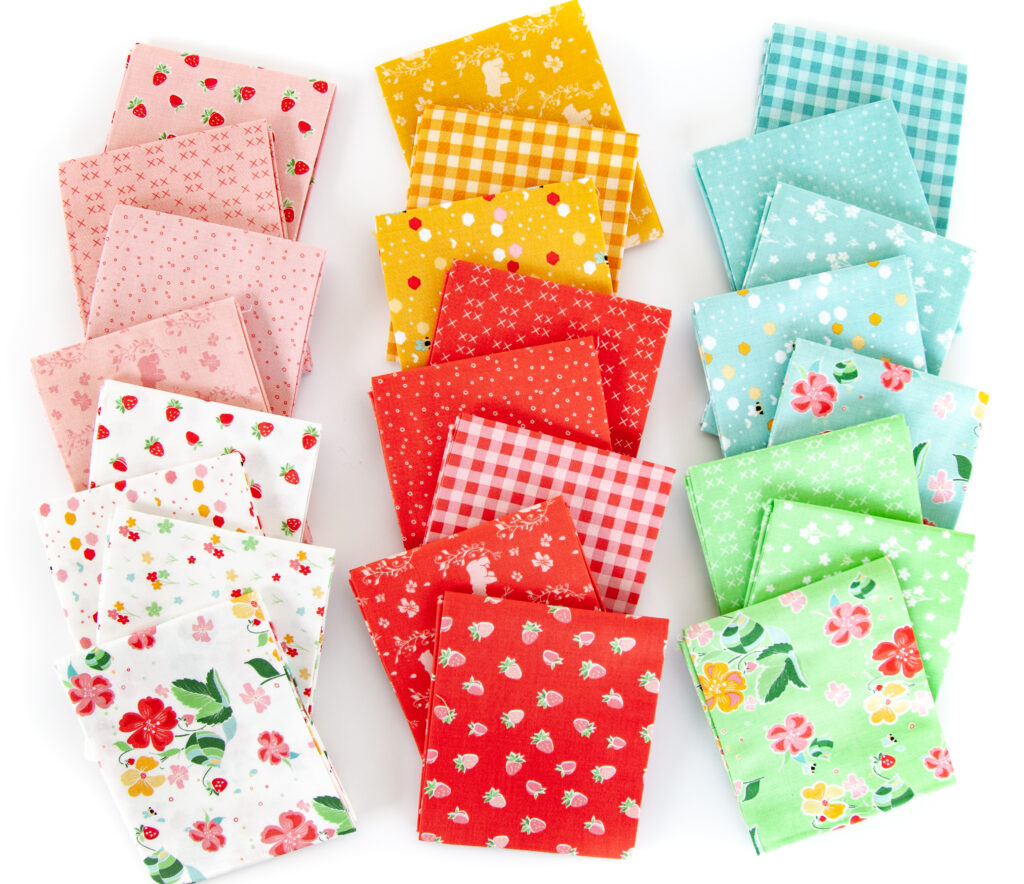 Strawberry Springtime mini quilt free pattern by top US sewing blog Ameroonie Designs. Image of fabric prints in Strawberry Honey fabric line.