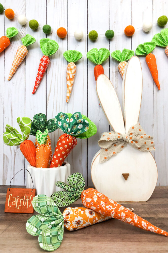 How to sew fabric carrots with top US sewing blog Ameroonie Designs. Image of wood bunny with medium and mini fabric carrots.