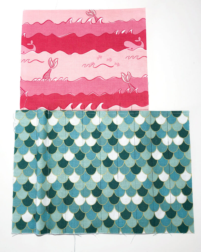 Sew a beautiful colored pencil pouch with top US sewing blog Ameroonie Designs. Image of sewn lines creating pencil pocket.