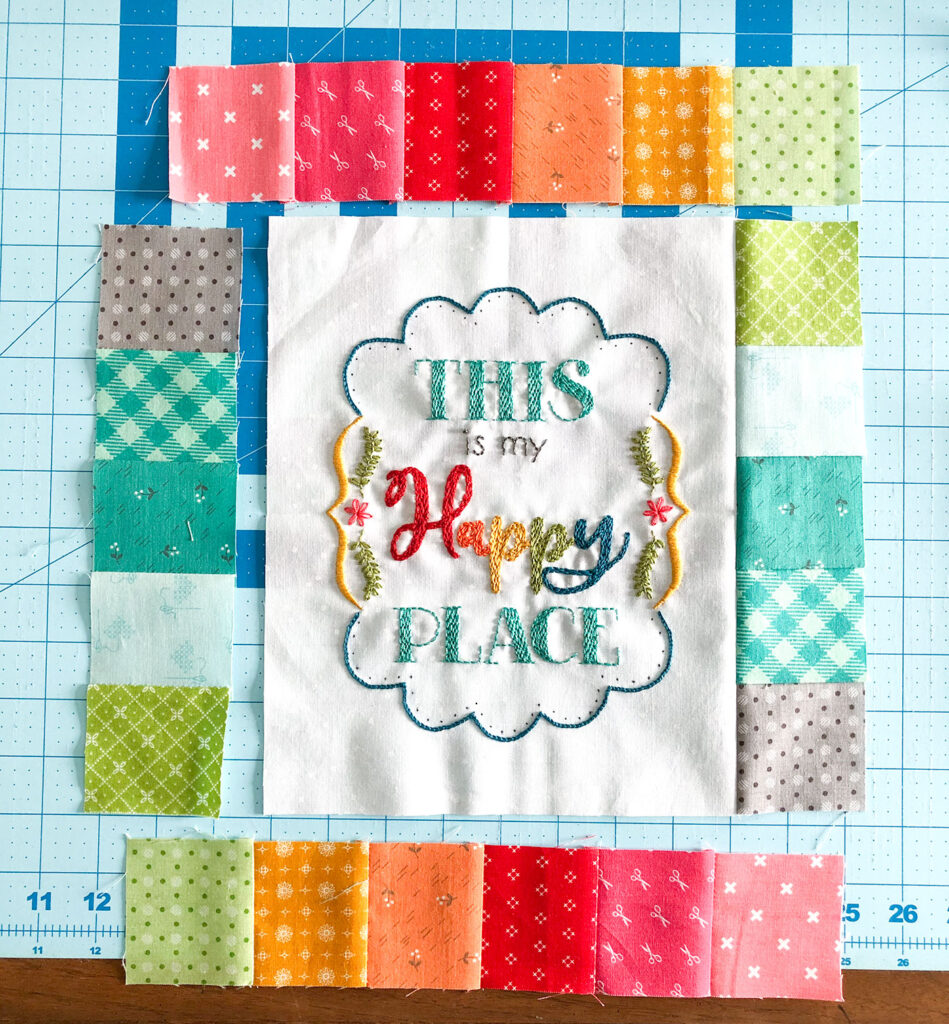 Turn your embroidery into a stunning mini quilt by Top US sewing blog Ameroonie Designs. Image of adding patchwork borders to mini quilt.