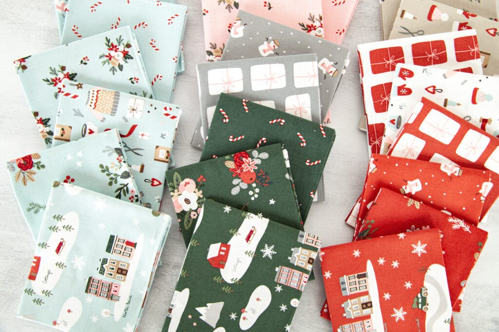 Gorgeous winter mini banner sneak peek with top US sewing blog Ameroonie Designs. Image of prints from Warm Winter Wishes fabric line.