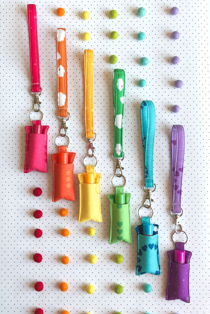 7 simple sewing projects to make this weekend from top US sewing blog Ameroonie Designs. Image of chapstick holders with wrist straps in rainbow order.