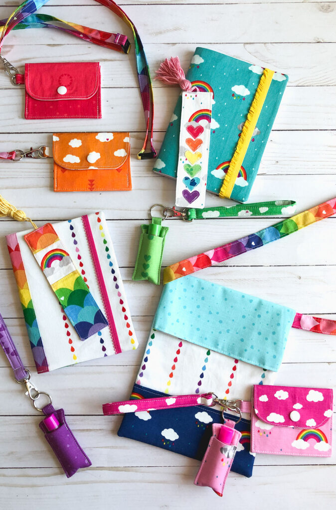7 simple sewing projects to make this weekend from top US sewing blog Ameroonie Designs. Image of mini wallets on lanyards, fabric covered notebooks, bookmarks and chapstick holders on wriststraps along with a sling tote all in Dream fabrics.