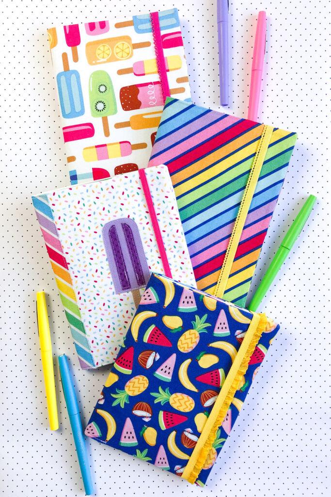 How to sew a fabric cover for a mini notebook with top US sewing blog Ameroonie Designs. Image of fabric covered mini compostion notebooks.