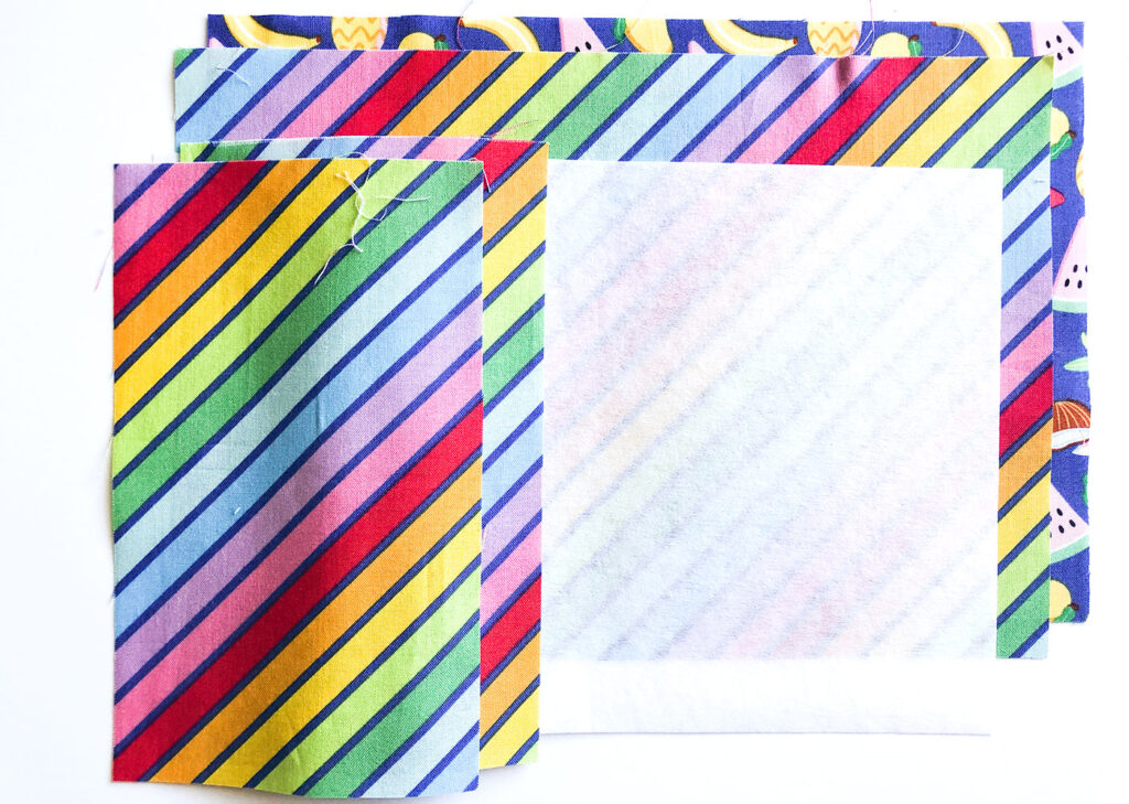 How to sew a fabric cover for a mini notebook with top US sewing blog Ameroonie Designs. Image of fabric requirements for notebook cover.