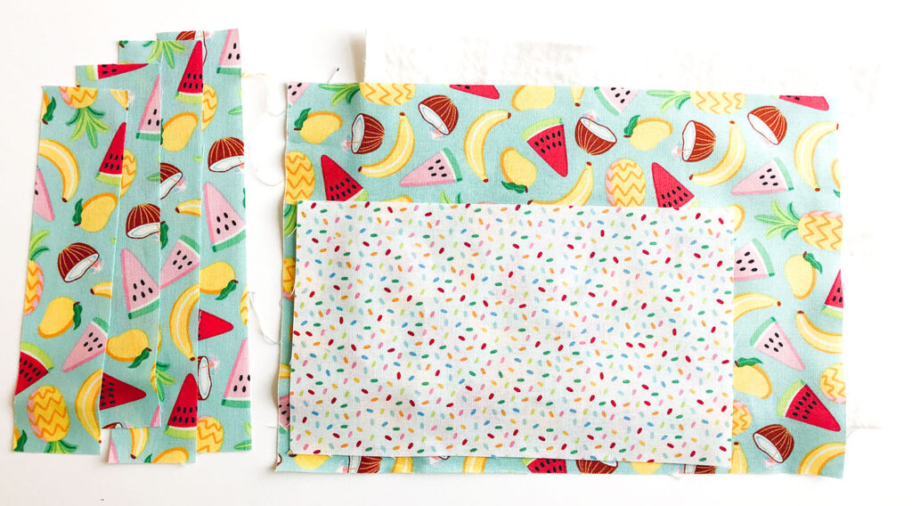 Free popsicle mug rug sewing tutorial with top US sewing blog Ameroonie Designs. Image of fabric pieces needed to make the mug rug.