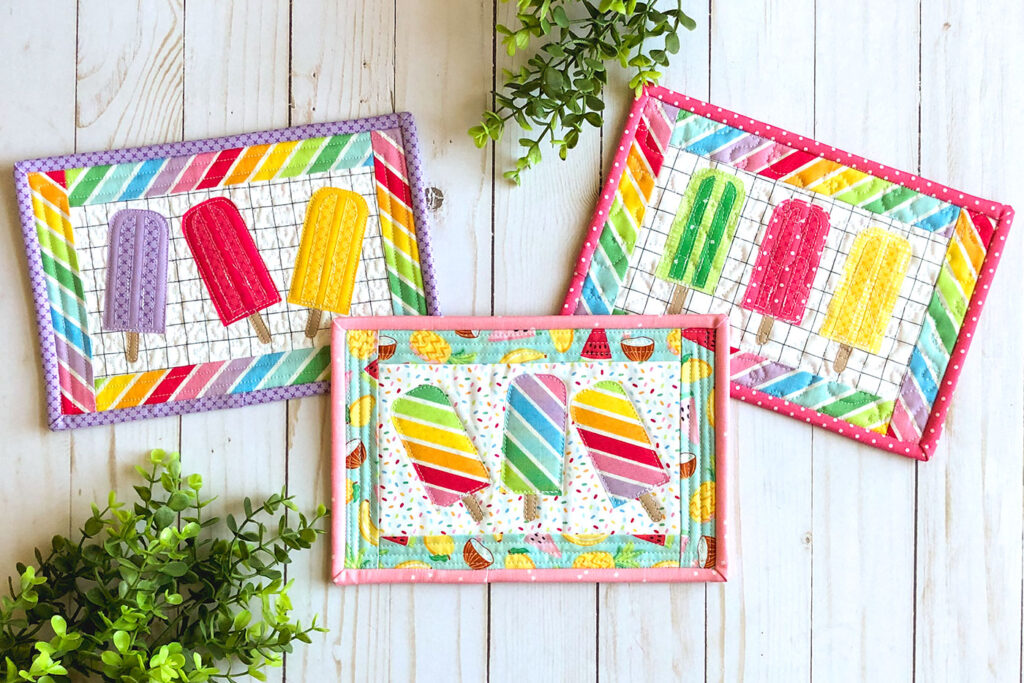 Free popsicle mug rug sewing tutorial with top US sewing blog Ameroonie Designs. Image of three mug rugs with applique popsicles.