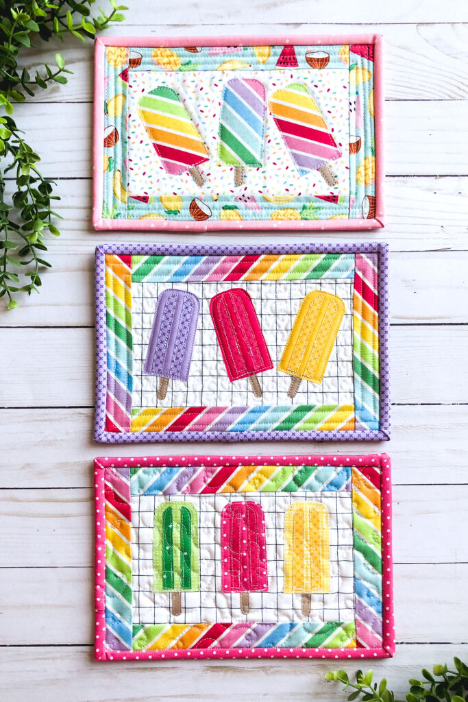 How to sew a fabric cover for a mini notebook with top US sewing blog Ameroonie Designs. Image of popsicle mug rugs in rainbowfruit fabrics.