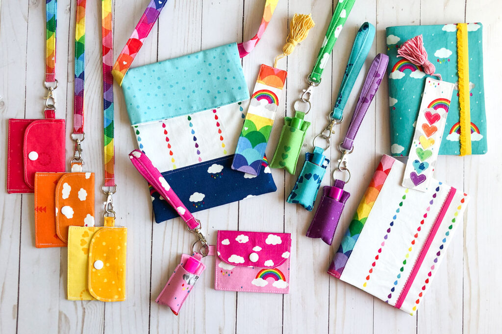 7 simple sewing projects to make this weekend from top US sewing blog Ameroonie Designs. Image of mini wallets, fabric lanyards, bookmarks, notebooks, tote bag, chapstick holder and keychains made from Dream fabric.