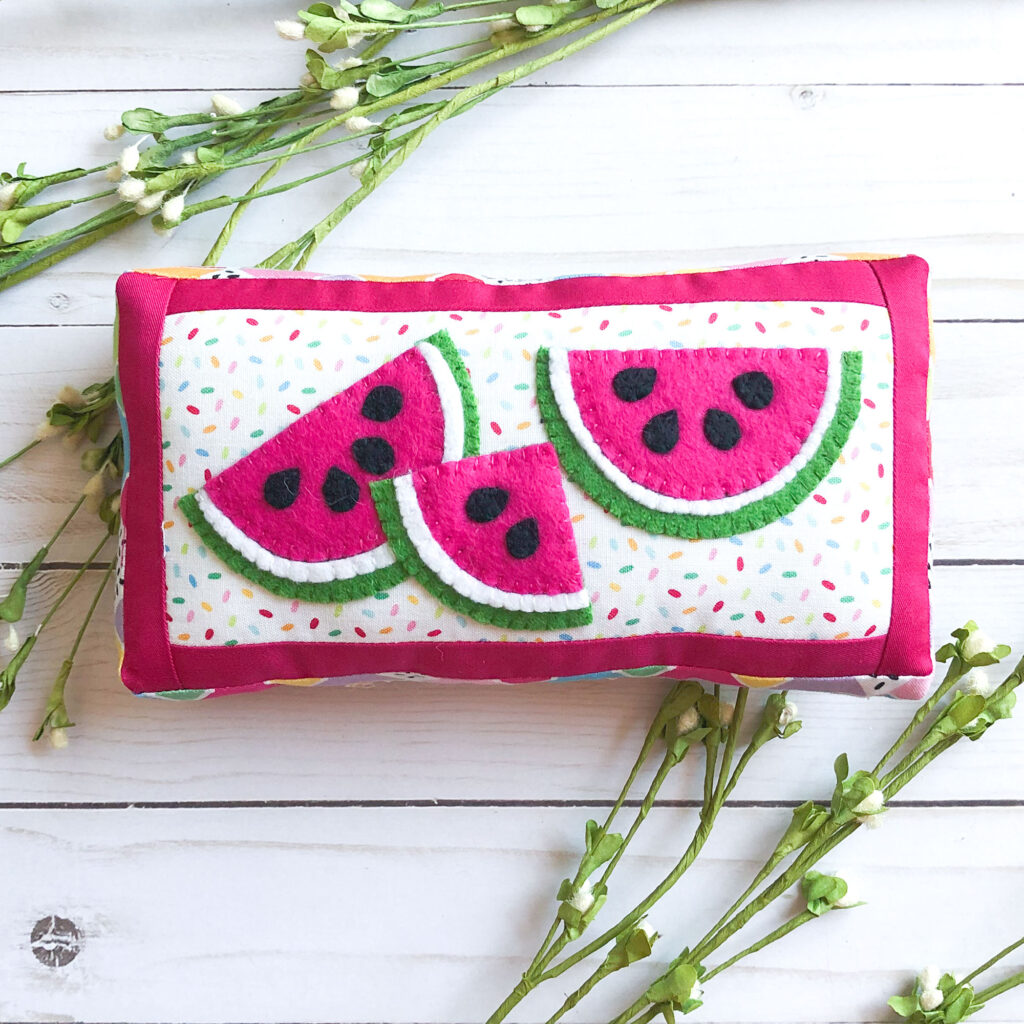 How to sew a fabric cover for a mini notebook with top US sewing blog Ameroonie Designs. Image of watermelon applique on mini pillow.