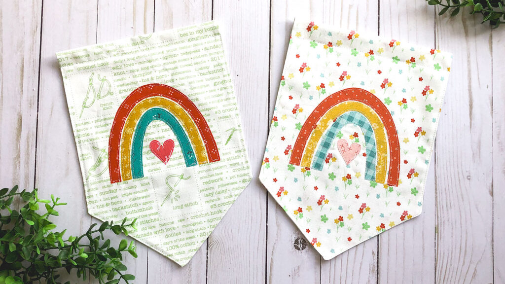 Sew your own colorful rainbow banner from top US sewing blog Ameroonie Designs. Image of fabric banners with rainbow applique.