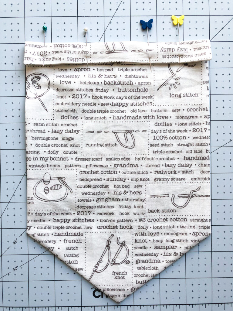 Sew your own colorful rainbow banner from top US sewing blog Ameroonie Designs. Image of creating a channel for dowel for hanging banner.