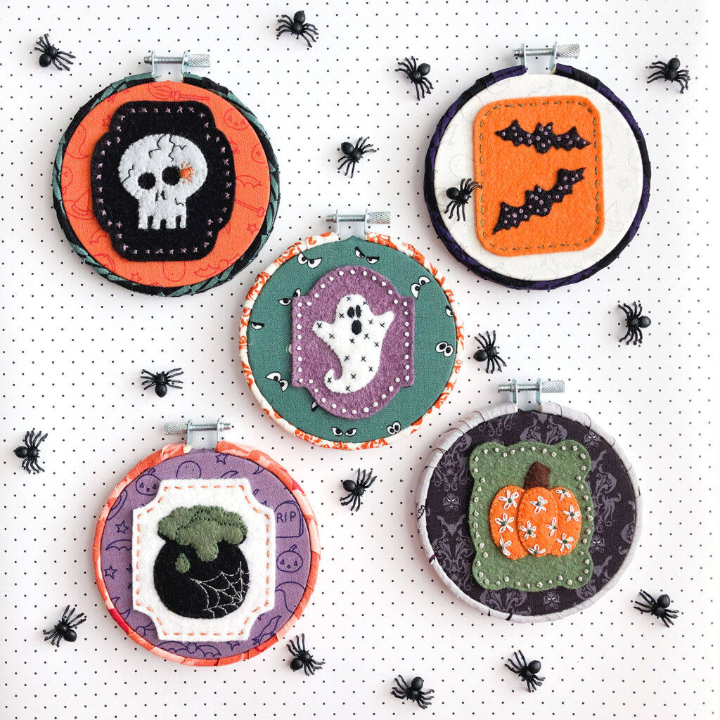 New Halloween Sewing patterns by top US sewing blog Ameroonie Designs. Image of felt applique Halloween ornaments with embroidery embellishments.